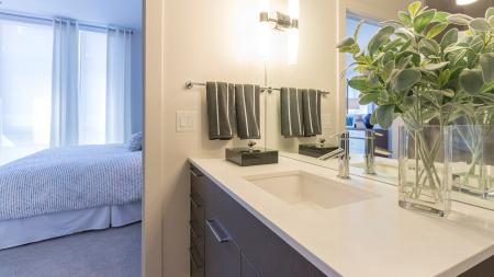 Quartz Counter in Bathroom with Modern Cabinets and Faucet | Modera Midtown