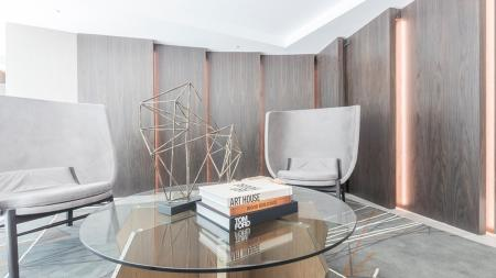 Lounge Chairs and Glass Coffee Table | Modera Midtown