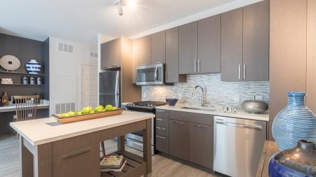 Kitchen Island with White Quartz Countertop in Modern Kitchen | Modera Midtown