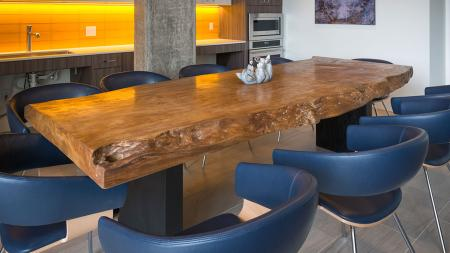 Natural Wood Dining Table in Clubhroom | Modera Ballard