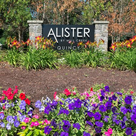 Welcome to Alister Quincy | Alister Quincy Monument Sign surrounded by beautiful landscaping