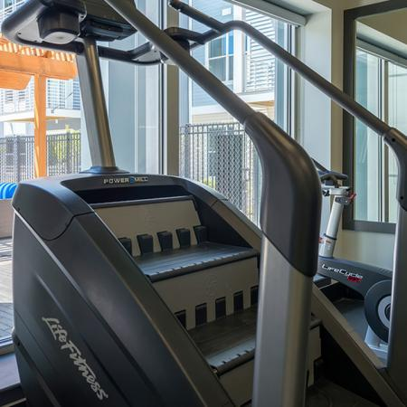 Cardio Machines Overlooking Pool Area | Modera Medford