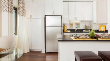 Upgraded Kitchens with White Cabinets and Stainless Appliances | Skye At Belltown