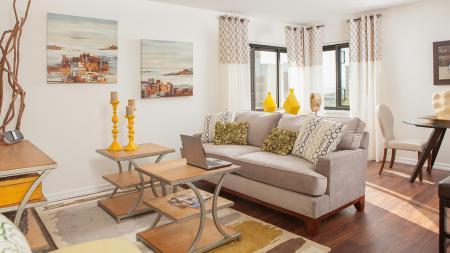 Living Room of One Bedroom Apartment with Wood Flooring   Skye At Belltown