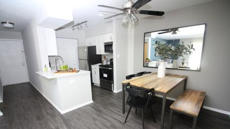 Open Kitchen and Dining Area with Modern Vinyl Wood Flooring | Alister Town Center Columbia