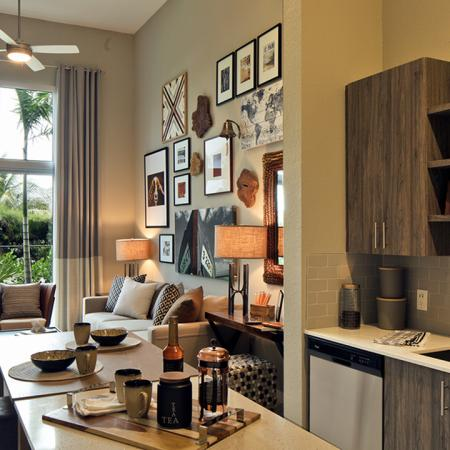 Kitchen and Living Area in Apartment Home | Modera Port Royale