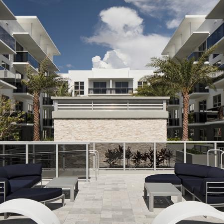 Outdoor Lounge with Chaise and Sofas | Modera Port Royale