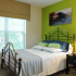 Vibrant bed room at the apartments for rent in Overland Park KS.