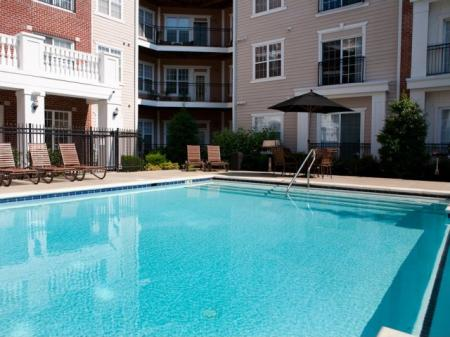 Swimming pool at The Alexander at Ghent Apartment Homes in Norfolk, VA