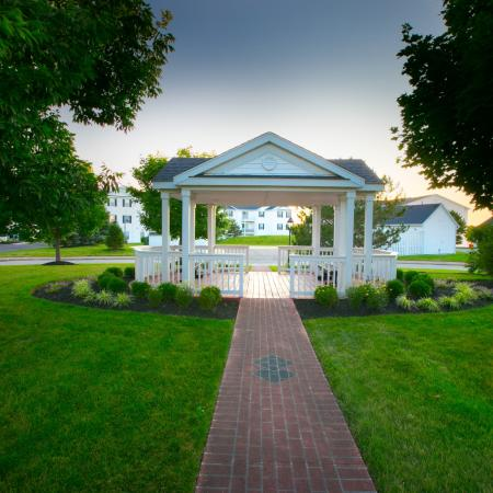 Enjoy the beautiful landscaping in our community gazebo at The Village of Western Reserve Apartments in Streetsboro, OH
