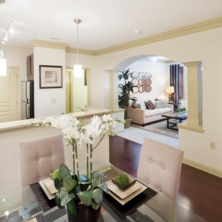 Living room and dining room at Apartments at the Arboretum in Cary, NC