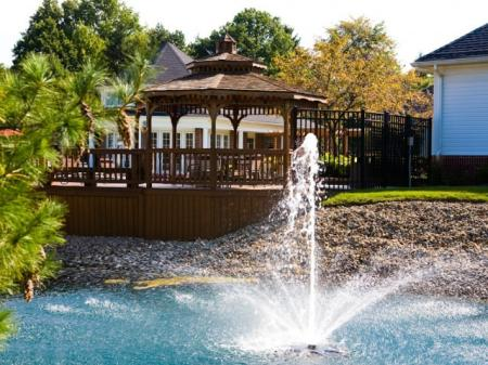Fountain by gazebo at The Village at Avon Apartments in Avon, OH.