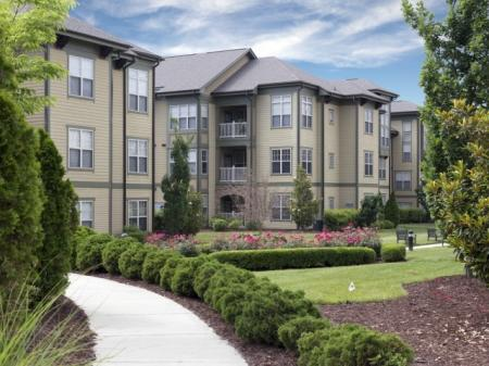 Pathway surrounded by lush greenery at Southpoint Village Apartments in Durham, NC
