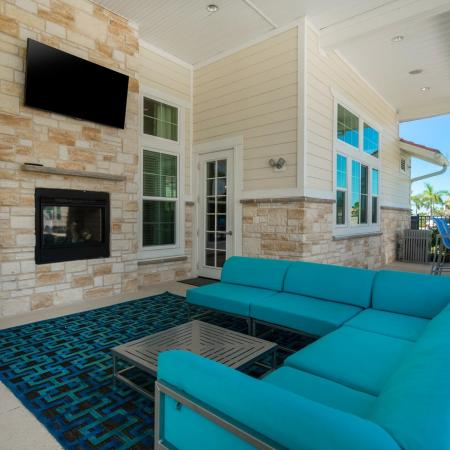 Pool Area Outdoor Living Room With Television and Seating