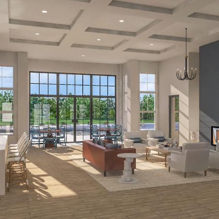 rendering of interior clubroom with sofas, tables and fireplace