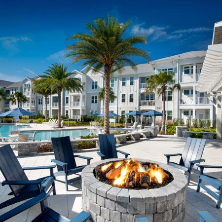 upclose of fire pit and pool and apartment buildings on sunny day