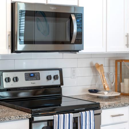 upclose of stove and microwave in kitchen