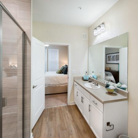 bathroom with glass doors and sink