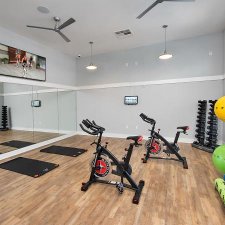 yoga and pilates fitness center gym with bicycles and exercise balls
