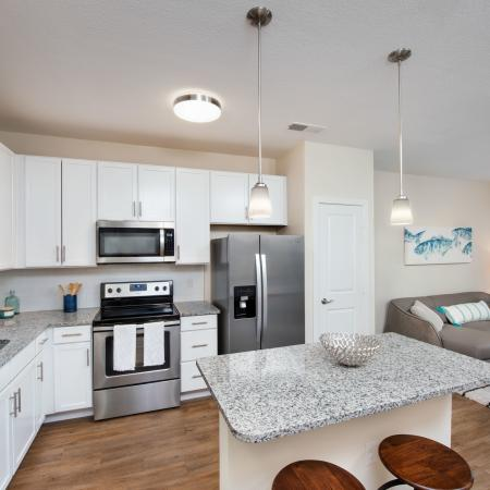 kitchen with island and appliances and sofa
